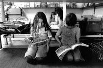 Pupils reading in a primary school library - John Harris - 1980s,1989,book,books,child,CHILDHOOD,children,EDU education,Enjoying,Enjoyment,female,females,girl,girls,juvenile,juveniles,kid,kids,libraries,library,people,Pupil,Pupils,READ,reading,READS,school,sc