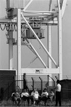 Picketing during the national dock strike Bristol, National Dock Labour Scheme abolished 1989 - John Harris - ,1980s,1989,DISPUTE,DISPUTES,dock,INDUSTRIAL DISPUTE,member,member members,members,people,picket,Picketing,pickets,Scheme,strike,STRIKERS,strikes,striking,tgwu,trade union,trade union,trade unions,Tra