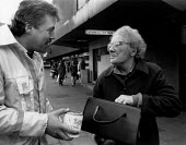 Pensioner giving money to Ambulance crew collecting in the street during their dispute. - John Harris - 09-12-1989