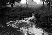 Sewage outflow from a treatment works into the river Avon Rugby - John Harris - 11-02-1990