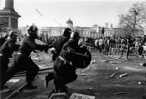 Police baton charge demonstrators Poll Tax riot Trafalgar Square London - John Harris - ,1990,1990s,activist,activists,adult,adults,attack,attacking,baton,batons,CAMPAIGN,campaigner,campaigners,CAMPAIGNING,CAMPAIGNS,charge,charging,CLJ,conflict,conflicts,DEMONSTRATING,demonstration,DEMON