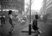 Demonstrators throw stones at Police on horseback Poll Tax riot Charing Cross Road London - John Harris - ,1990,1990s,activist,activists,adult,adults,animal,animals,BAME,BAMEs,black,BME,BME Black minority ethnic,bmes,CAMPAIGN,campaigner,campaigners,CAMPAIGNING,CAMPAIGNS,CLJ,conflict,conflicts,cultural,DEM