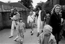 Parents collecting children from school gates - John Harris - 1990,1990s,adult,adults,child,CHILDHOOD,children,collecting,EDU education,families,FAMILY,FEMALE,gate,gates,infancy,INFANT,infants,junior,juvenile,juveniles,kid,kids,MATURE,mother,MOTHERHOOD,MOTHERING