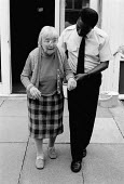 Social services day centre worker with disabled pensioner - John Harris - 14-08-1990