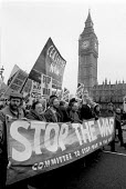 Jeremy Corbyn MP Committee to Stop War in the Gulf banner passes Houses of Parliament. Demonstration against war in the Gulf London - John Harris - 02-02-1991