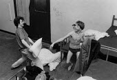 Homeless youth having fun, a pillow fight at The Boot night shelter Birmingham 1991, for young men up to 16yrs. They spend their days on the street - John Harris - 19-05-1991
