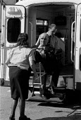 Ambulance crew load a disabled out patient - John Harris - 10-05-1991
