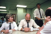 Female HGV driver for Tesco goods distribution with fellow male drivers in the works canteen - John Harris - 07-08-1991