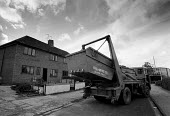 Lorry removing a skip Local Authority housing being refurbished Bristol - John Harris - 24-10-1991