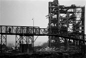 Mother and pushchair crossing a footbridge over of the demolished Askern Colliery, Yorkshire coalfield 1993 - John Harris - 1990s,1993,building,buildings,capitalism,capitalist,closed,closing,closure,closures,Coal Industry,Coal Mine,Coalfield,coalindustry,collieries,colliery,cross,crosses,crossing,deindustrialisation,Deindu