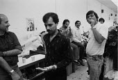 Asian men taking a break from work in a Leicester sweatshop producing textiles. The workers have low pay and poor conditions - John Harris - 21-04-1993
