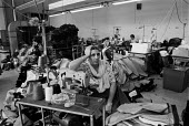Women taking a break from work in a Leicester sweatshop producing textiles. The workers have low pay and poor conditions - John Harris - 21-04-1993