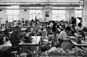 Asian men and women working in a Leicester sweatshop producing textiles. The workers have low pay and poor conditions - John Harris - 21-04-1993