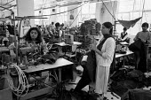 Asian women working in a Leicester sweatshop producing textiles. The workers have low pay and poor conditions - John Harris - 21-04-1993