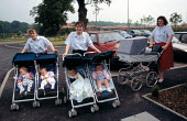 Carers with babies in prams and push chairs at a nursery which cares for office workers children enabling them continue their work nearby - John Harris - 04-06-1993