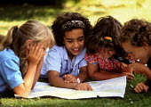 Junior and Primary School pupils looking at map of the area in a city park, geography lesson. London - John Harris - 09-07-1993