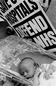 Baby sleeping during a demonstration to save South London Hospitals - defend the NHS and the medical treatment provided - John Harris - 21-08-1993
