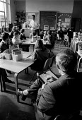 OFSTED - Office For Standards in Education inspector inspecting class teaching at a midlands Junior school. - John Harris - 18-11-1993