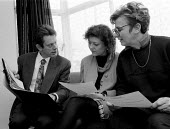 OFSTED - Office For Standards in Education inspector inspecting class teaching at a midlands Junior school. Talking to teachers in staff room - John Harris - 18-11-1993