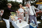 Wealthy picnickers enjoying strawberries and cream, champaign, Henley Royal Regatta Henley on Thames 1993 - John Harris - 10-07-1993