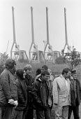 Striking dockers picketing in the rain King George Dock Hull 1984. The strike was called by the TGWUs national docks committee after British Steel had used workers who were not registered dockers to u... - John Harris - 10-07-1984