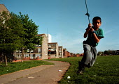 Child playing on council estate Bute Town Cardiff South Wales 4/5/95 - John Harris - 04-05-1995