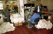 Sowing jeans together at sweatshop in an old sewing machine factory Leicester - John Harris - 16-08-1996