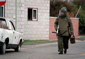 Army bomb disposal squad training with protective clothing for finding and defusing explosive devices and associated booby traps often in Northern Ireland - approaching a suspect package - John Harris - 09-10-1996