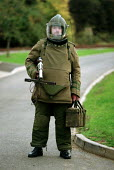 Army bomb disposal squad training with protective clothing for finding and defusing explosive devices and associated booby traps often in Northern Ireland - John Harris - 1990s,1996,apparel,army,bomb,BOMBS,clothing,explosive,Ireland,IRISH,mod,Northern Ireland,scene,scenes,security,SERVICE,SERVICES,SKILL,SKILLED,SKILLS,Soldier,SOLDIERS,street,streets,The Troubles,TRAINE