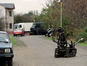 Army bomb disposal squad training with protective clothing for finding and defusing explosive devices and associated booby traps often in Northern Ireland Here a robot is used - John Harris - 09-10-1996