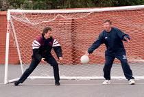 Tony Blair playing football Labour Party conference 1996 with Sir Alex Ferguson - John Harris - 1990s,1996,conference,conferences,football,Party,PLAY,playing,POL politics,SPO sport