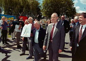 Sacked GCHQ workers march back into the Government intelligence base after 4,860 days fighting the ban on trades unions imposed in 1984. GCHQ Cheltenham - John Harris - 25-07-1997