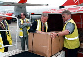 TUC leader John Monks trying his hand at baggage handling during a work place visit to Gatwick airport 7.9.97 - John Harris - ,1990s,1997,air transport,airline,airport,AIRPORTS,Gatwick,handling,job,jobs,LAB LBR work,leader,member,member members,members,MONK,Monks,people,trade union,trade union,trade unions,trades union,trade