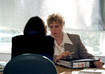 Managing staff at a utilities company - John Harris - 1990s,1997,ASSESSING,Assessment,boss,bosses,company,EBF business,female,graduate,graduates,hyder,interview,interviewed,INTERVIEWER,interviewing,interviews,job,jobs,LAB LBR work,management,manager,MANA