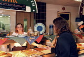 Canteen worker serving food to staff at a utilities company - John Harris - 1990s,1997,BREAK,Canteen,CANTEENS,Catering,company,DINNER,dinners,DINNERTIME,eating,ebf economy business,employee,employees,Employment,europeregi,female,food,FOODS,job,jobs,LAB LBR work,LBR,lunch,LUNC