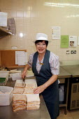 Catering worker preparing food in staff canteen at a utilities company - John Harris - 1990s,1997,canteen,CANTEENS,catering,company,ebf economy,EMOTION,EMOTIONAL,EMOTIONS,employee,employees,Employment,europeregi,female,food,FOODS,health,job,jobs,kitchen,KITCHENS,LAB LBR work,LBR,people,