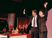 Tony Blair Prime Minister and Cherie Blair acknowledging applause Labour Party Conference 1997 Brighton - John Harris - 1990s,1997,Conference,conferences,Labour Party,Party,POL,POL politics,political,POLITICIAN,POLITICIANS,Politics,SPEAKER,SPEAKERS,speaking,SPEECH