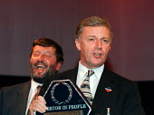 John Monks TUC receiving Investors in People award from Labour MP David Blunkett TUC 1997 Brighton - John Harris - 1990s,1997,Investors,member,member members,members,MONK,Monks,people,Trade Union,Trade Union,trade unions,Trades Union,Trades Union,trades unions,TUC,worker,workers