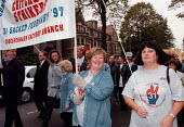 CWU Critchley labels workers marching in Cardiff - John Harris - 1990s,1997,CWU,female,labels,marching,member,member members,members,people,recognition,solidarity,trade union,trade union,trade unions,Trades Union,Trades Union,trades unions,union,worker,workers