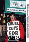 Protesting against cuts in public expenditure on social services Oxford 8.11.97 - John Harris - 1990s,1997,activist,activists,against,CAMPAIGN,campaigner,campaigners,CAMPAIGNING,CAMPAIGNS,capping,care,CARER,carers,cuts,DEMONSTRATING,DEMONSTRATION,DEMONSTRATIONS,member,member members,members,Oxfo