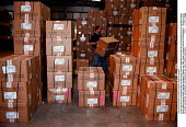 Warehouse storage of textile products awaiting transport - John Harris - 1990s,1997,capitalism,capitalist,DELIVERING,Delivery,EBF economy business,FACTORIES,factory,goods,Industries,industry,job,jobs,LAB LBR work,maker,makers,making,manufacture,manufacturer,manufacturers,M