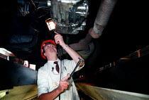 Worker inspecting an HGV, MOT testing at a Heavy Vehicle test centre - John Harris - 27-11-1997