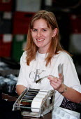 Young woman working in a textile factory Leicester - John Harris - 05-11-1997