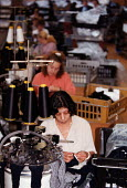 Production line at a textiles factory manufacturing socks Counterpart - John Harris - 1990s,1997,apparel,asian,BAME,BAMEs,black,BME,BME Black minority ethnic,bmes,capitalism,capitalist,clothing,diversity,EARNINGS,EBF Economy,EQUALITY,ethnic,ethnicity,FACTORIES,factory,female,garment,In