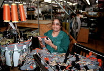 Textile worker producing socks Counterpart Leicester - John Harris - 1990s,1997,apparel,asian,BAME,BAMEs,black,BME,BME Black minority ethnic,bmes,capitalism,capitalist,diversity,EARNINGS,EBF Economy,EQUALITY,ergonomic,ergonomics,ethnic,ethnicity,FACTORIES,factory,femal