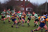 University rugby match. teamwork - Roy Peters - 1990s,1997,ball,balls,COMPETITATIVE,competition,Edu Education,Higher Education,male,man,men,people,person,persons,rugby,shirt,shirts,SPO sport,STUDENT,STUDENTS,tackle,undergraduate,UNDERGRADUATES,Univ