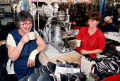 Women workers at Doc Martin boots factory take a break from the manufacturing process with a cup of tea on the shop floor - John Harris - ,1990s,1997,boots,break,capitalism,capitalist,EBF economy business,FACTORIES,factory,female,floor,Industries,industry,job,jobs,LAB LBR work,maker,makers,making,manufacture,manufacturer,manufacturers,m