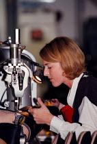 Women worker at Doc Martin boots factory during the manufacturing - John Harris - ,1990s,1997,boots,capitalism,capitalist,ebf economy business,employee,employees,Employment,europeregi,FACTORIES,factory,female,Industries,industry,industry Manufacturing,job,jobs,KFAT,LAB LBR work,LBR