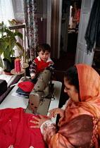 Home worker sewing, earning a low wage. Bradford - John Harris - 03-03-1998