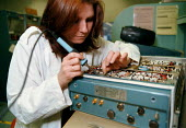 Civilian Ministry of Defense technician working on electronic equipment at RAF Sealand base - John Harris - ,1990s,1998,agency,air transport,applied,armed forces,aviation,capitalism,capitalist,defence,defense,DERA,EBF Economy,ELECTRONIC,electronics,engineer,engineering,engineers,equipment,female,Industries,
